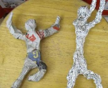 Action figure sculptures of aluminum foil